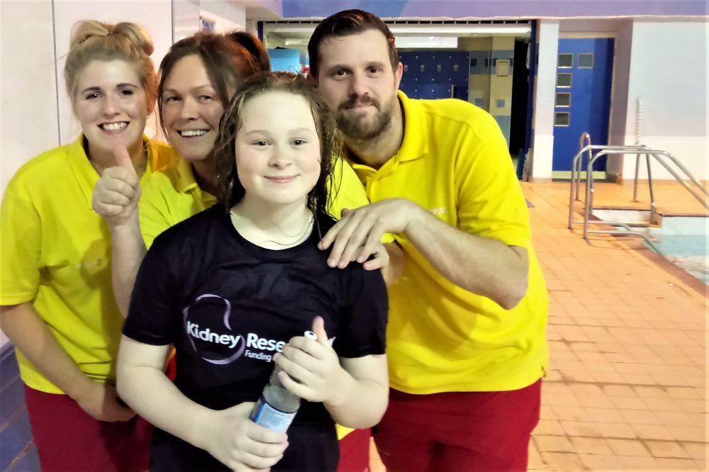 Hannah Hughes, with lifegaurds at the pool