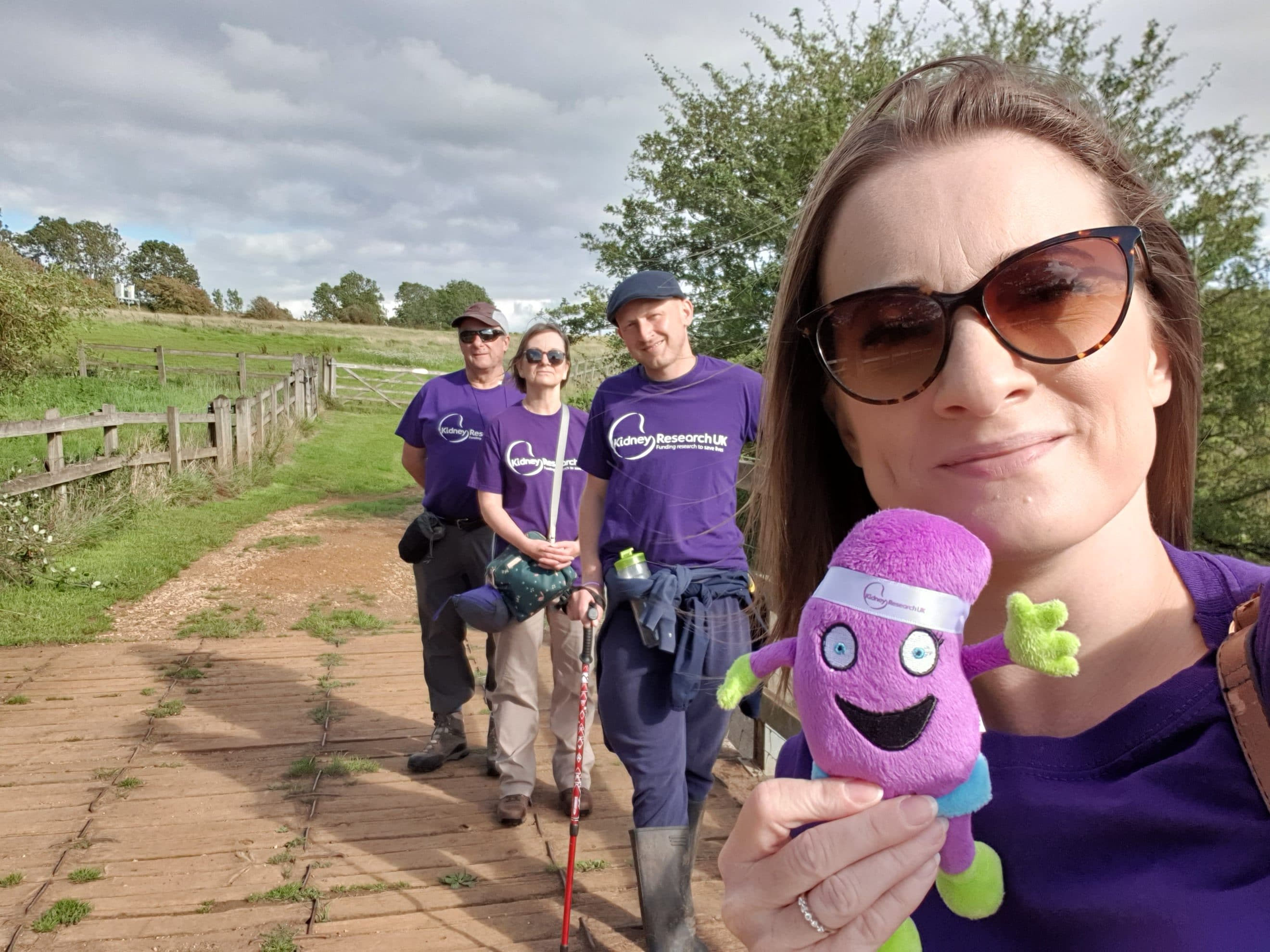 Kathryn Croker with her husband Luke and mum Anne and dad Kevin on the charity walk in Rushton
