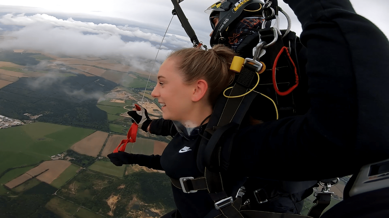 Eliza completing her parachute jump.