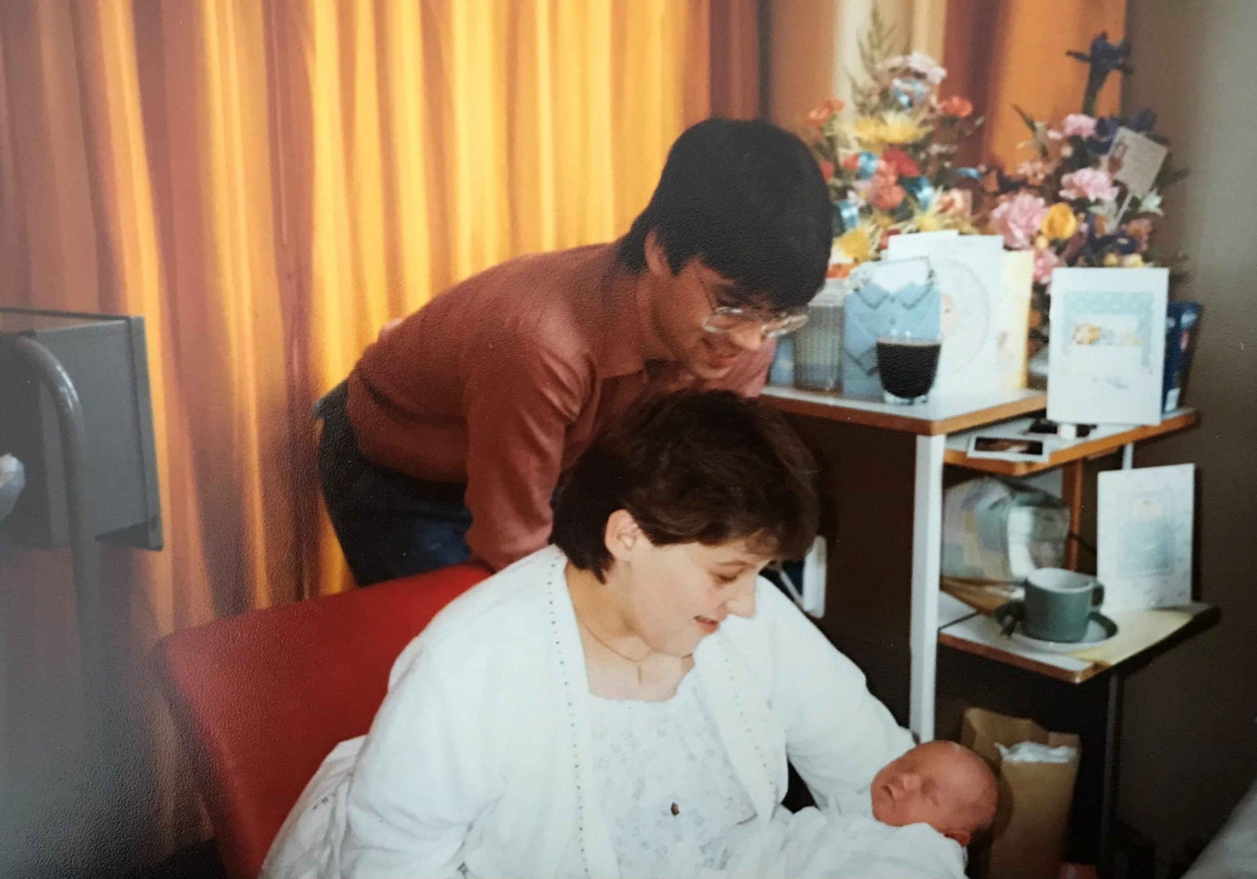 Ben as a baby with his parents before being diagnosed